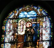Stained glass windows in a church Stock Images