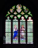 Stained glass windows in church Stock Photography