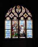 Stained glass windows in church Stock Images
