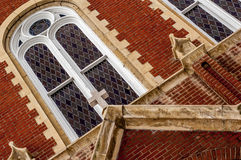 Stained glass windows on a Church. Stained glass windows on the outside of a Church royalty free stock images