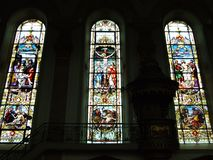 Stained Glass on the windows of the church of St. Mauritius in the city of Appenzell stock images