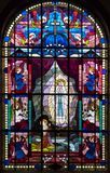 Stained glass windows of a church stock image