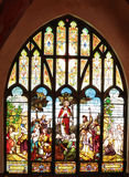 Stained glass windows. Church stained glass windows with varicolored images on religious the biblical story royalty free stock image