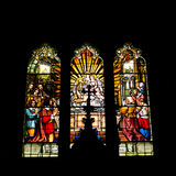 Stained glass window. S with crucifix silhouette Stock Photo
