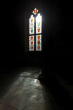 Stained glass windows in dark Winchester castle Stock Photos