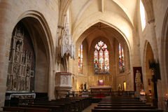 Stained-glass windows decorate the choir of Saint-Eloi church in Bordeaux (France) royalty free stock photography