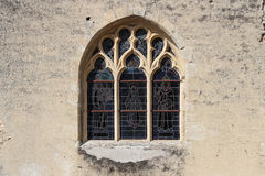 Stained-glass windows decorate the facade of a church in Occagnes (France). Stained-glass windows decorate the facade of a church in Occagnes, France, on June 29 royalty free stock photography