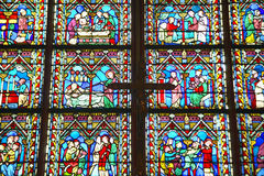 Stained glass windows inside the Notre Dame Cathedral, Paris, France Royalty Free Stock Image