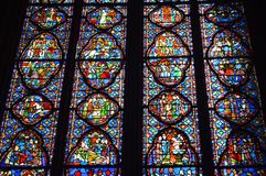 Beautiful stained glass windows in Sainte-Chapelle Paris France. Stained Glass windows at Sainte-Chapelle a royal chapel in the Gothic style, within the medieval Royalty Free Stock Photography