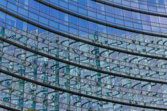 Stained glass windows of the skyscraper mirror. Stock Image
