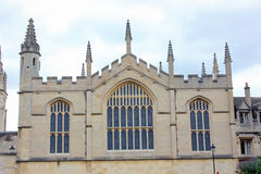 Wall of the All Souls College, Oxford University, England. Stained glass windows and spires are a common feature of architecture of most medieval buildings at Stock Image