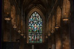 Stained Glass Windows in St Giles` Cathedral, Edinburgh. Stained Glass Windows in the main hall of St Giles` Cathedral. The Gothic Church in the center of old Royalty Free Stock Photography