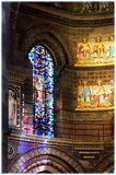 Stained glass windows in Strasbourg Cathedral. Cathedral in Strasbourg, interior, stained glass windows near the altar Royalty Free Stock Image