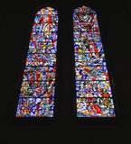 Stained glass windows. Two colorful oval long stained glass windows in Catholic Church Stock Photo