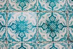 Decorative turquoise tiles on a building in Lisbon, Portugal. Stained, hand-painted `azulejo` tiles decorating a building on the streets of Lisbon, Portugal Royalty Free Stock Images
