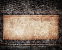 Stained leather jeans label sewed on jeans. Royalty Free Stock Image
