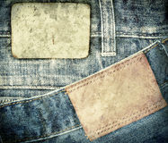 Stained leather jeans label sewed on jeans. Stock Images