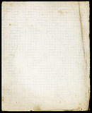 Stained lined old paper with folded corner and faded lower part Stock Photo