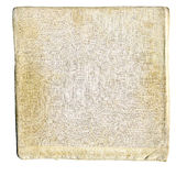 Stained Linen. Square with embossed detail at center and handsewn edges.  Object of indeterminate use showing wear, age and preservation.  Object is isolated on Royalty Free Stock Images