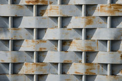 Stained Pattern. The vertical steel plate is weaved with horizontal rod Royalty Free Stock Image