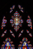 Stained Saints Top. Multiple Panel Red Blue Yellow Purple and Green Stained Glass Images of Christian Saints In Red Robes Standing with Various Biblical Figures royalty free stock photo