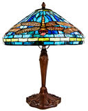 Stained Tiffany Glass Table Lamp. With Dragon Fly Pattern stock photo