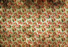 Stained vintage floral wallpaper. Background texture of stained vintage floral wallpaper with discoloured patches and a busy repeat pattern of pink roses with stock photo