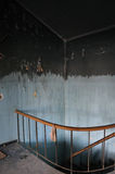Stained wall and staircase in abandoned house Stock Photo