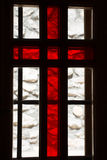 Stained window with red cross in a church Stock Photos