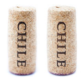 Chile Wine Corks. A stained wine cork with 'Chile' written on it,  on white background, in vertical position with the writing pointing downwards Royalty Free Stock Image