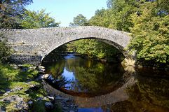 Stainforth Packhorse Bridge. Stainforth bridge. A single span masonry packhorse bridge of uncertain date, most likely built in the 17th century. The roadway over Royalty Free Stock Photography