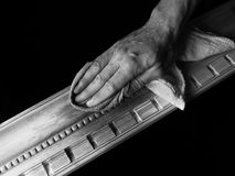 Staining Wood Molding. Male hands staining wood molding Stock Images