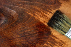 Staining wooden surface. Home decorating concept. Royalty Free Stock Photography