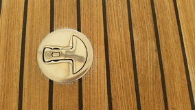 Stainlass steel Deck fitting and teak decking background Royalty Free Stock Images
