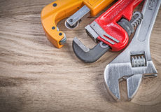 Stainless adjustable spanner monkey wrench pipe cutter on wooden Royalty Free Stock Photography