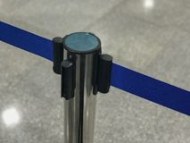 Stainless barricade with blue rope. Close up of Stainless barricade with blue rope Royalty Free Stock Image
