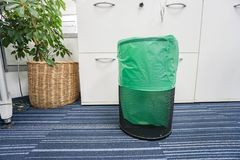 Stainless bin with green plastic bag in office Royalty Free Stock Photography