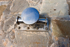 Stainless Boat Bollard on Stone Pier Royalty Free Stock Photos