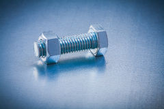 Stainless bolt detail with screw nut on metallic Royalty Free Stock Image