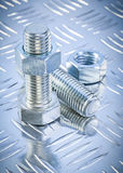Stainless bolt details and threaded construction nuts on channel Royalty Free Stock Photos