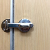 Stainless bolt the doors locked of restroom in hotel. Royalty Free Stock Photography