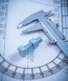 Stainless bolt with screw nut roller bearings on. Blueprint construction concept Stock Photo