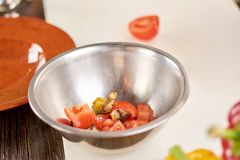 Stainless bowl with fresh chopped vegetables. stock photography