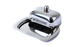 Stainless butterdish on a white background. Series. Stainless butterdish on a white background Stock Image