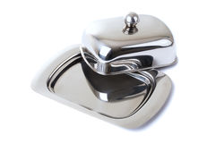 Stainless butterdish on a white background. Series. Stainless butterdish on a white background Stock Images