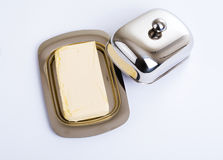Stainless butterdish on a white background. Series. Stainless butterdish on a white background Royalty Free Stock Images