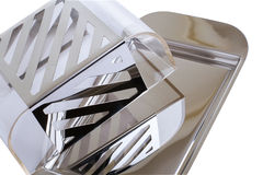 Stainless butterdish on a white background Royalty Free Stock Image