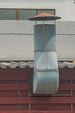 Stainless chimney on rooftop. royalty free stock photography