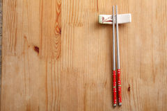 Stainless chopstick. On the wooden background stock photography
