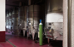 Stainless cisterns with fermenting wine in fabric Stock Photo